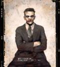The Joker posing for a mug shot in the 1940s.