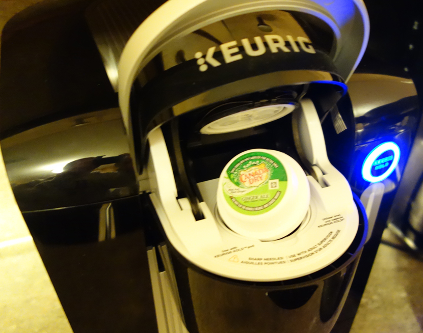 Keurig KOLD Drinkmaker on Counter with Canada Dry Ginger Ale Pod