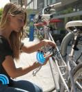 Girl-Locking-bike-with-Noke